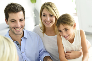Family Conversing with Investment Specialist